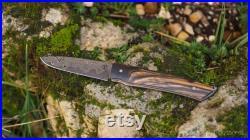 Couteau pliant à friction, lame en damas et manche en ébène royal